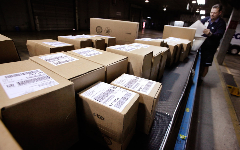 Packages on a conveyor belt in the FedEx shipping center on N. Santa Fe on  Monday,  Dec. 12, 2011.    Photo by Jim Beckel, The Oklahoman