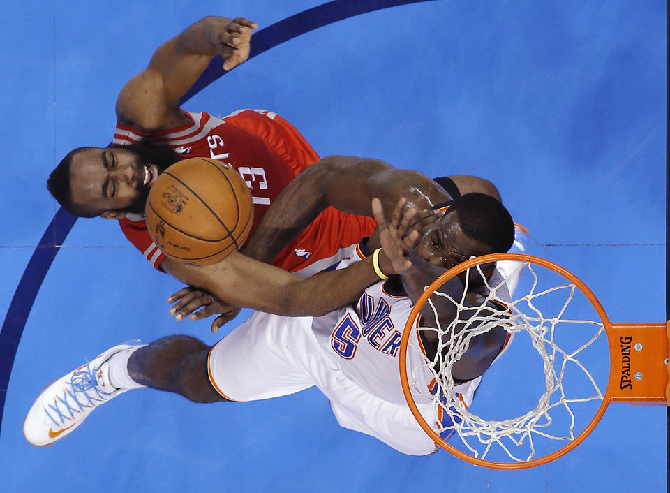 Houston\'s James Harden (13) and Oklahoma City\'s Kendrick Perkins (5) battle under the basket during Game 2 in the first round of the NBA playoffs between the Oklahoma City Thunder and the Houston Rockets at Chesapeake Energy Arena in Oklahoma City, Wednesday, April 24, 2013. Photo by Chris Landsberger, The Oklahoman