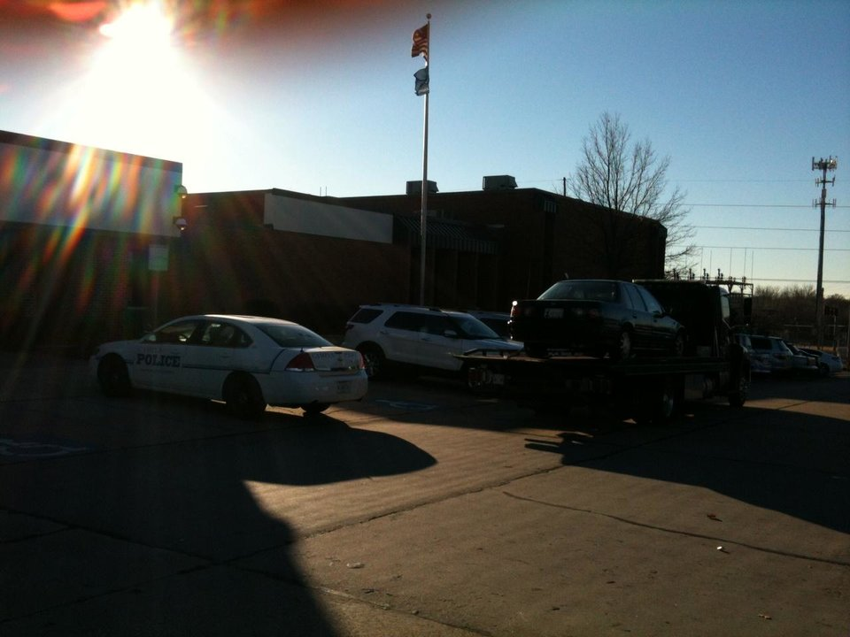 Car being towed away from Capps Middle School - Photo by Robert Medley