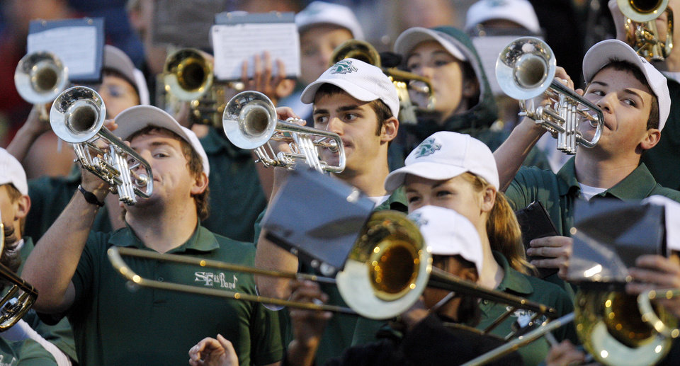 Photo - The Edmond Santa Fe band plays in the stands during a high school football game between Midwest City and Edmond Santa Fe at Wantland Stadium in Edmond, Okla., Thursday, Sept. 15, 2011. Photo by Nate Billings, The Oklahoman