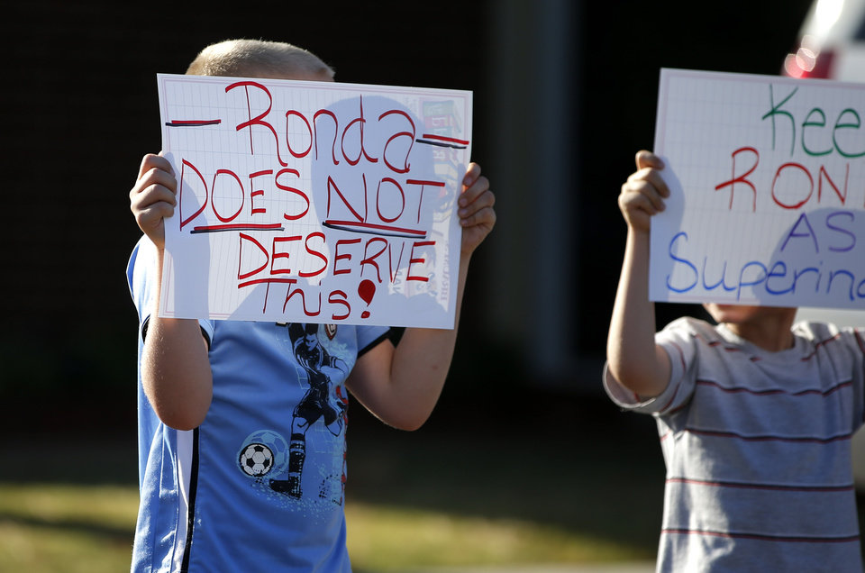 Photo -  Children show support for Noble Schools Superintendent Ronda Bass during a Noble Board of Education meeting to decide her employment status in Noble, Okla., Tuesday, Sept. 2, 2014. Bass came under fire for her alleged inappropriate enforcement of the school's dress code. Photo by Bryan Terry, The Oklahoman   Bryan Terry -  THE OKLAHOMAN