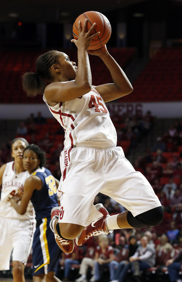 Oklahoma Sooner's Jasmine Hartman (45) shoots as the University of Oklahoma Sooners (OU) play the West Virginia Mountaineers in NCAA, women's college basketball at The Lloyd Noble Center on Wednesday, Jan. 2, 2013  in Norman, Okla. Photo by Steve Sisney, The Oklahoman