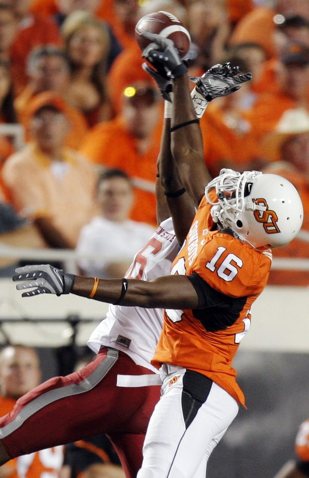 Photo - OSU's Andrae May breaks up a pass intended for Marquess Wilson of WSU during the college football game between the Washington State Cougars (WSU) and the Oklahoma State Cowboys (OSU) at Boone Pickens Stadium in Stillwater, Okla., Saturday, September 4, 2010. OSU won, 65-17. Photo by Nate Billings, The Oklahoman