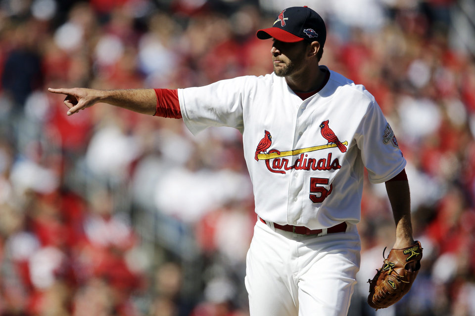 St. Louis Cardinals starting pitcher Adam Wainwright point after striking out Washington Nationals\' Ryan Zimmerman to end the top of the first inning in Game 1 of baseball\'s National League division series, Sunday, Oct. 7, 2012, in St. Louis. (AP Photo/Jeff Roberson)