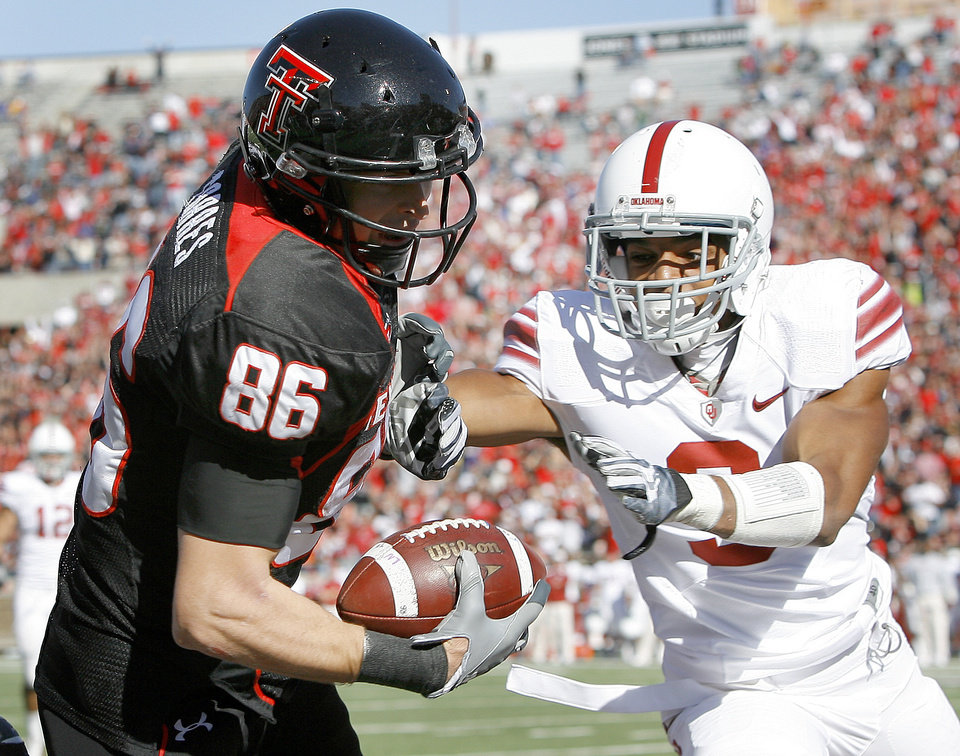 Texas Tech's Alexander Torres catches a pass for a touchdown in front of OU's Jonathan Nelson during the college football game between the University of Oklahoma Sooners (OU) and Texas Tech University Red Raiders (TTU ) at Jones AT&T Stadium in Lubbock, Texas, Saturday, Nov. 21, 2009. Photo by Bryan Terry, The Oklahoman