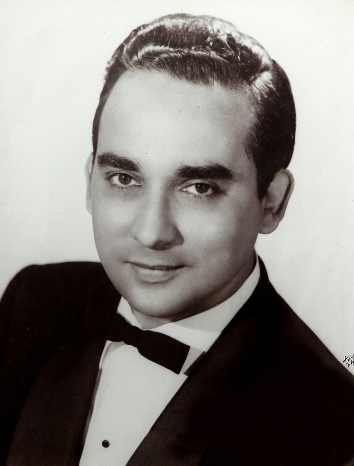 "Portrait of Miguelito Miranda when he was a young band leader in Puerto Rico. Miguelito and Olga Miranda married five months ago and are beginning a life together as husband and wife after a nearly 70 year separation.  Miguelito and Olga were neighbors in Puerto Rico and childhood sweethearts, described by both as the other's ""first love.'   Both married other people and their lives took them in different directions; Olga married a serviceman and  came to America while Miguelito married a woman and became a famous  band leader of a Latin orchestra,  In later years, their spouses died, leaving them both alone and lonely.  Miguelioto began a search to find his first love and he proposed to her on her 90th birthday.  The couple was married in September, 2011. They are photographed in their home in Del City on Monday, Feb. 13, 2012,