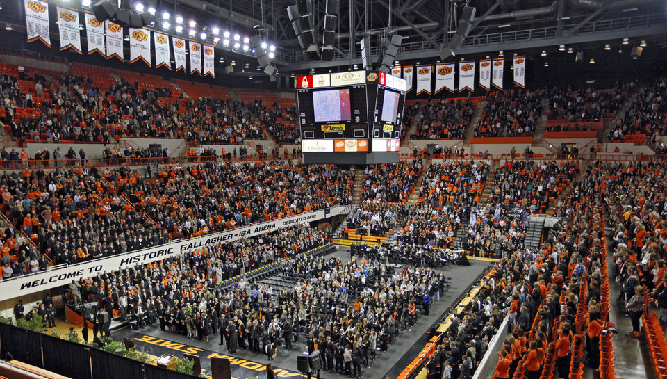 Photo - Supporters fill the arena during the memorial service for Oklahoma State head basketball coach Kurt Budke and assistant coach Miranda Serna at Gallagher-Iba Arena on Monday, Nov. 21, 2011 in Stillwater, Okla. The two were killed in a plane crash along with former state senator Olin Branstetter and his wife Paula while on a recruiting trip in central Arkansas last Thursday. Photo by Chris Landsberger, The Oklahoman