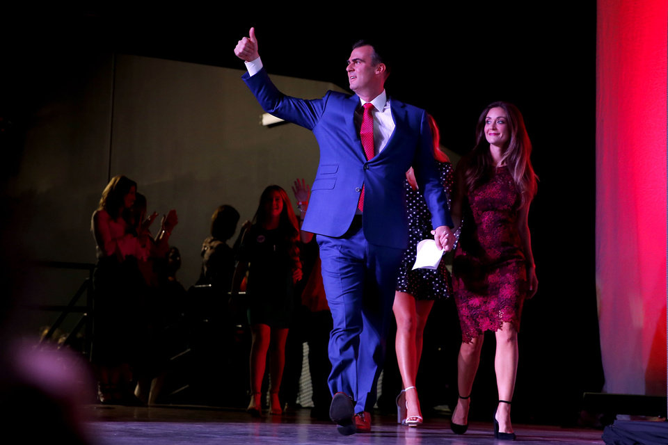 Photo - Kevin and Sarah Stitt take the stage during the Republican election night watch party for the 2018 elections at the Bricktown Events Center in Oklahoma City, Nov. 6, 2018. Photo by Bryan Terry, The Oklahoman