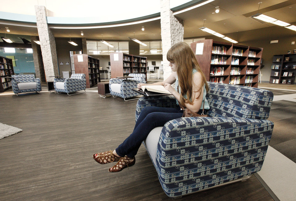 Photo - Mariah Cooksey, 15, reads in the new media center at Deer Creek High School.