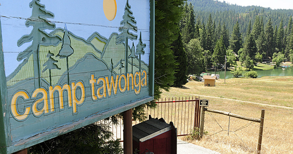 The entrance to Camp Tawonga is shown in Groveland, Calif., Wednesday, July 3, 2013. Four adults were injured and one remained unaccounted for after a large oak tree fell Wednesday at a summer camp near Yosemite National Park, authorities said. No children were hurt. The tree took down power lines but did not fall on any buildings at Camp Tawonga in rural Tuolumne County, sheriff's spokesman Sgt. Jim Oliver said. (AP Photo/The Sonora Union Democrat, Maggie Beck)