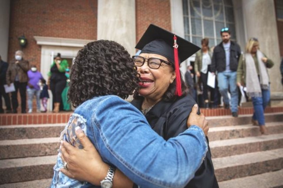 Photo -  JoAnn Bowler, right, gets a hug from her niece, Stephanie Lynn Greene, after Bowler graduated at the 2020 winter commencement ceremony at Oklahoma Baptist University. [Kenny Day/OBU]