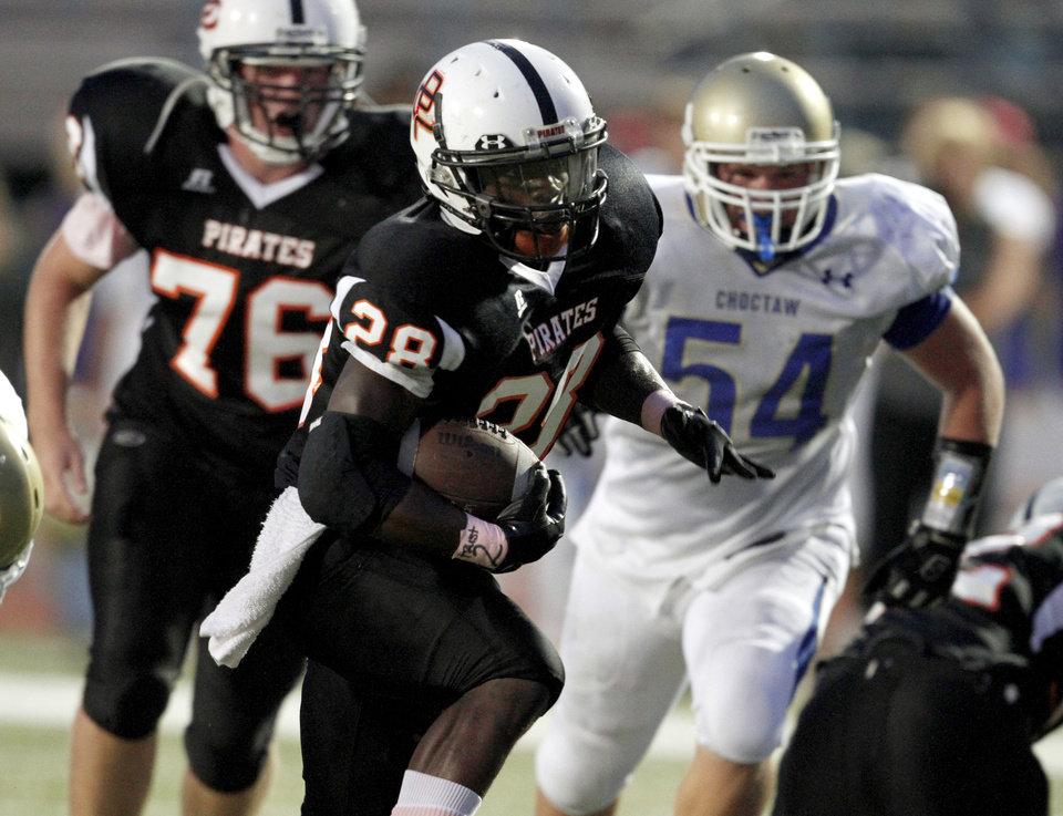 Photo - Putnam City's Desmond Tilly runs the ball during a high school football game between Putnam City and Choctaw in Oklahoma CIty, Thursday, September 16,  2010.  Photo by Bryan Terry, The Oklahoman
