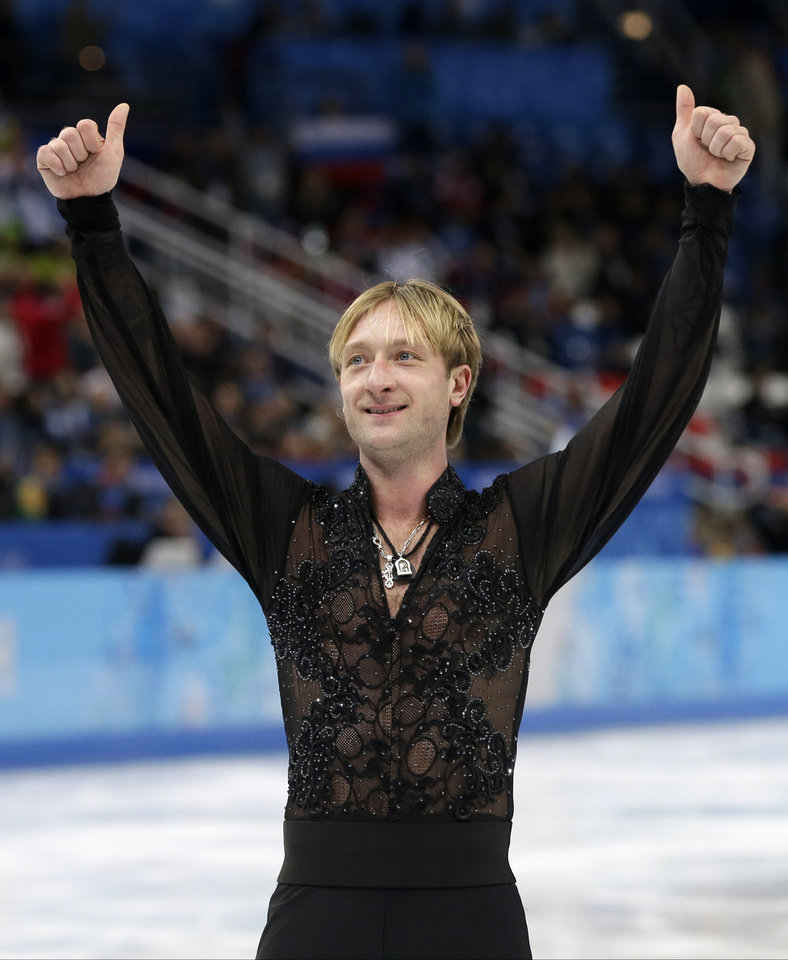 Photo - Evgeni Plushenko of Russia gestures to spectators as he leaves the ice after competing in the men's team free skate figure skating competition at the Iceberg Skating Palace during the 2014 Winter Olympics, Sunday, Feb. 9, 2014, in Sochi, Russia. (AP Photo/Darron Cummings, Pool)