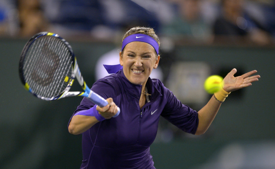 Photo - Victoria Azarenka, of Belarus, returns a shot to Kirsten Flipkens, of Belgium, during their match at the BNP Paribas Open tennis tournament, Monday, March 11, 2013, in Indian Wells, Calif. (AP Photo/Mark J. Terrill)