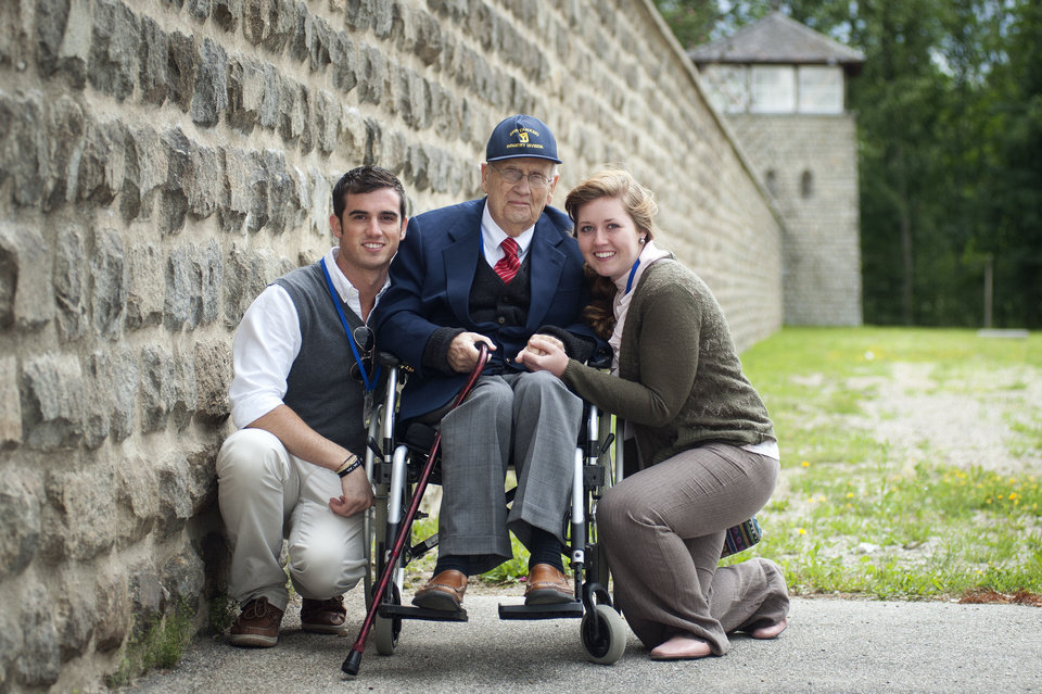 Photo - Edmond resident Hall Duncan poses, center, with College of the Ozarks students Austin Plummer, left, and Bonnie Andersen at Mauthausen-Gusen concentration camp in Austria during a tour of the camps. Photos provided
