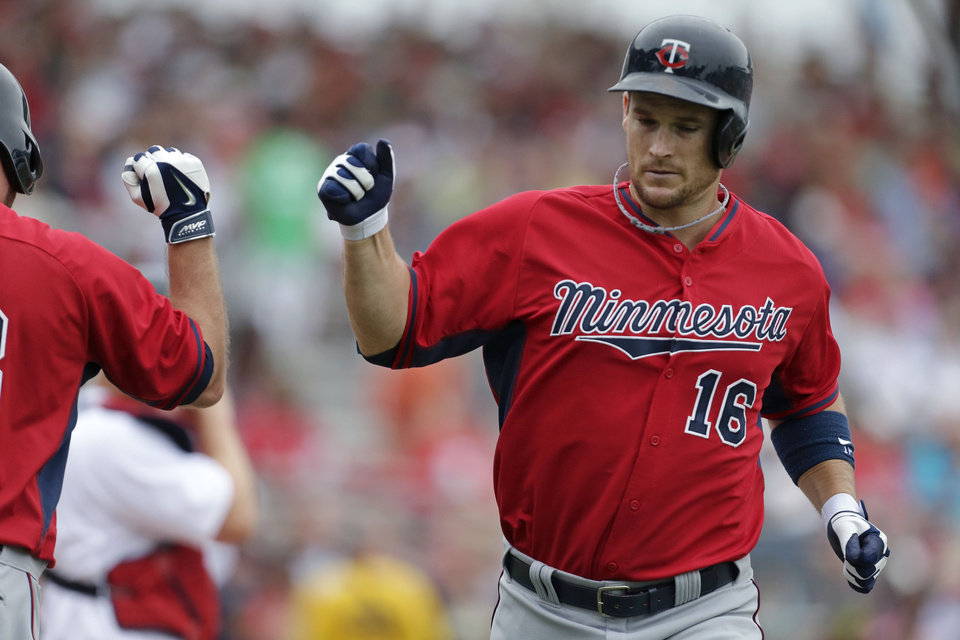 Photo - Minnesota Twins' Josh Willingham (16) is greeted by Jason Kubel after hitting a solo home run during the second inning of an exhibition baseball game against the Boston Red Sox in Fort Myers, Fla., Saturday, March 29, 2014. (AP Photo/Gerald Herbert)