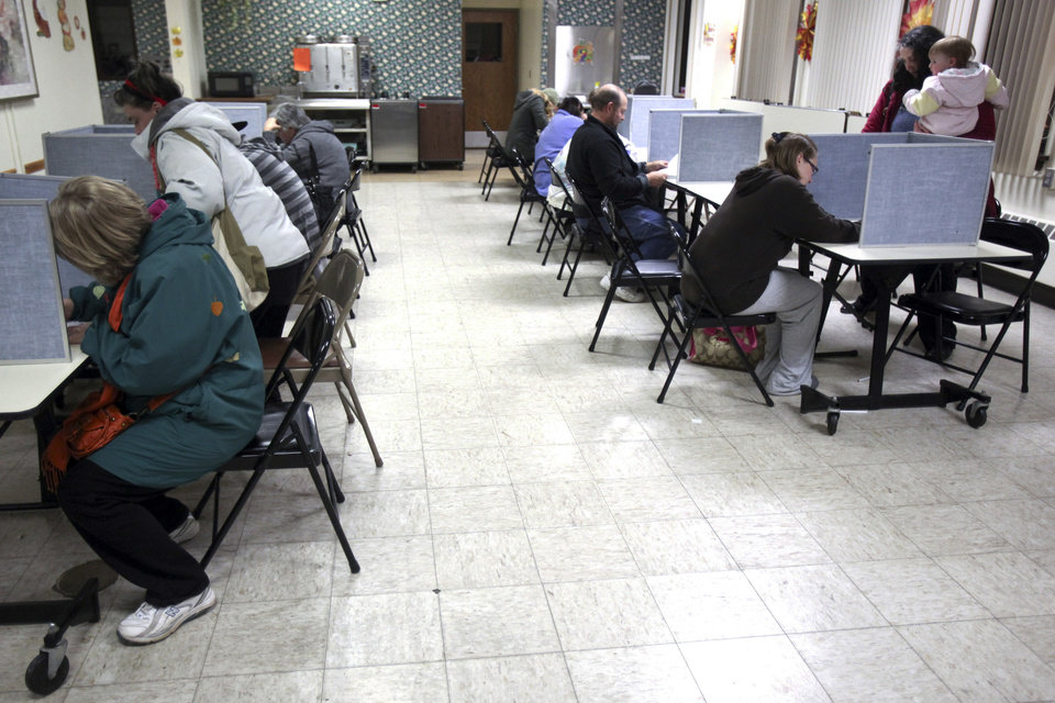 Photo -   People fill the voting booths at the Lincoln Park Senior Center for the general election the night of Tuesday, Nov. 6, 2012, in Duluth, Minn. (AP Photo/The Duluth News-Tribune, Clint Austin)