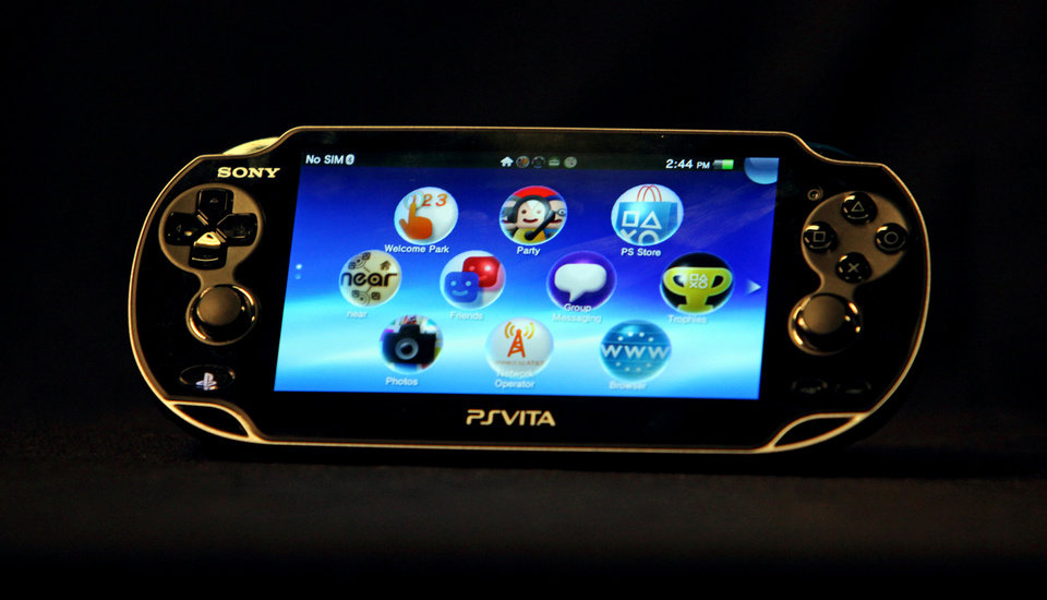 Photo - The Playstation PS Vita is a standalone gaming device that also can serve as a second screen, interacting remotely with the PS3 in your home. AP PHOTO BY REED SAXON.  Reed Saxon