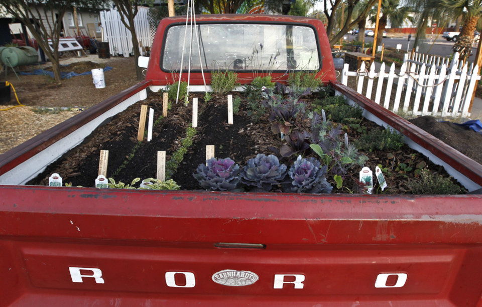 With its unique garden beds like the back of this pickup, The Growhouse, a boutique and community garden, is a popular attraction along Roosevelt Row neighborhood shown Tuesday, Nov. 27, 2012, in Phoenix.  The neighborhood is home to First Friday Art Walk, a Phoenix tradition since 1994, promoting local artists, shops.(AP Photo/Ross D. Franklin)