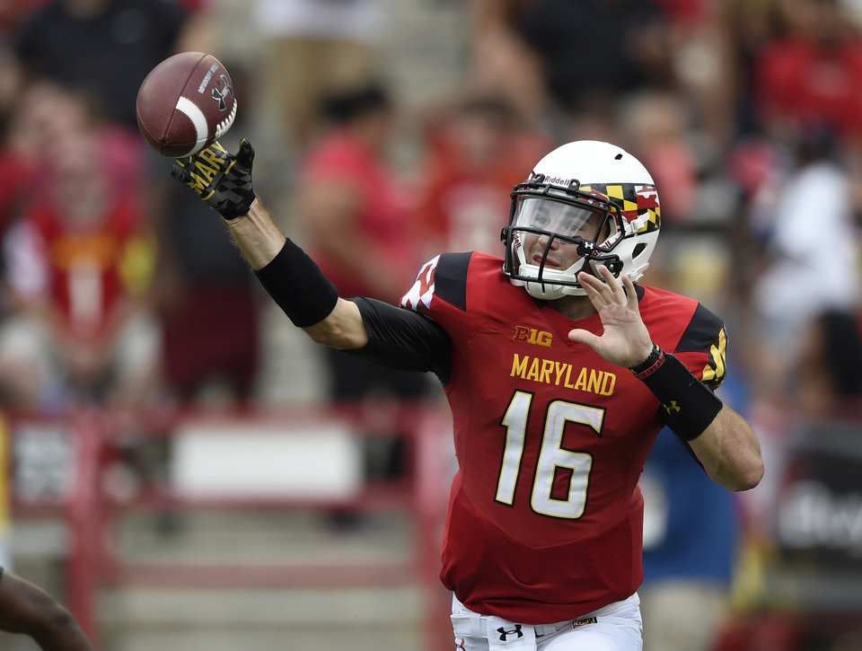 Photo - Maryland quarterback C.J. Brown (16) passes during the first half of an NCAA college football game against James Madison, Saturday, Aug. 30, 2014, in College Park, Md. (AP Photo/Nick Wass)