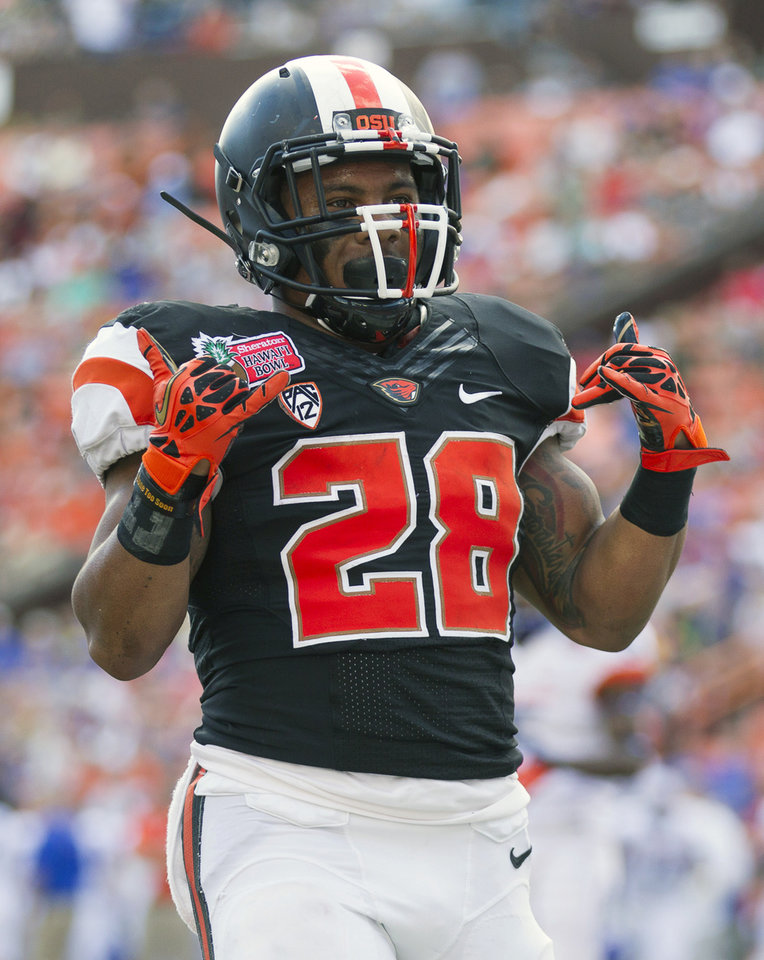 Oregon State running back Terron Ward (28) celebrates after scoring a touchdown in the second quarter of the Hawaii Bowl NCAA college football game against Boise State, in Honolulu, Tuesday, Dec. 24, 2013. (AP Photo/Eugene Tanner)