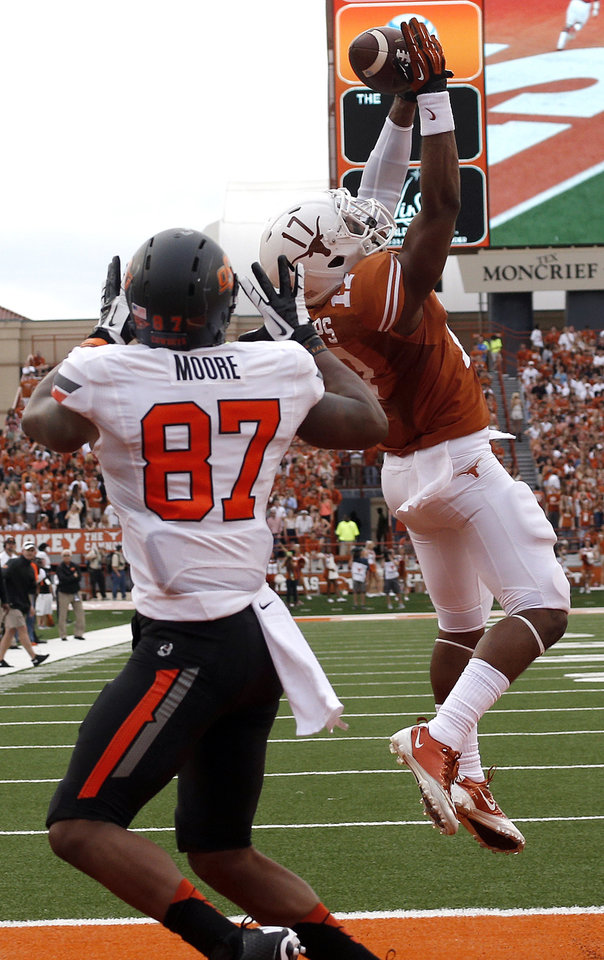 UT's Adrian Phillips (17) attempts to pick of a pass as Oklahoma State's Tracy Moore (87) prepares to make a touchdown pass during a college football game between the Oklahoma State University Cowboys (OSU) and the University of Texas Longhorns (UT) at Darrell K Royal - Texas Memorial Stadium in Austin, Texas, Saturday, Nov. 16, 2013. Photo by Sarah Phipps The Oklahoman