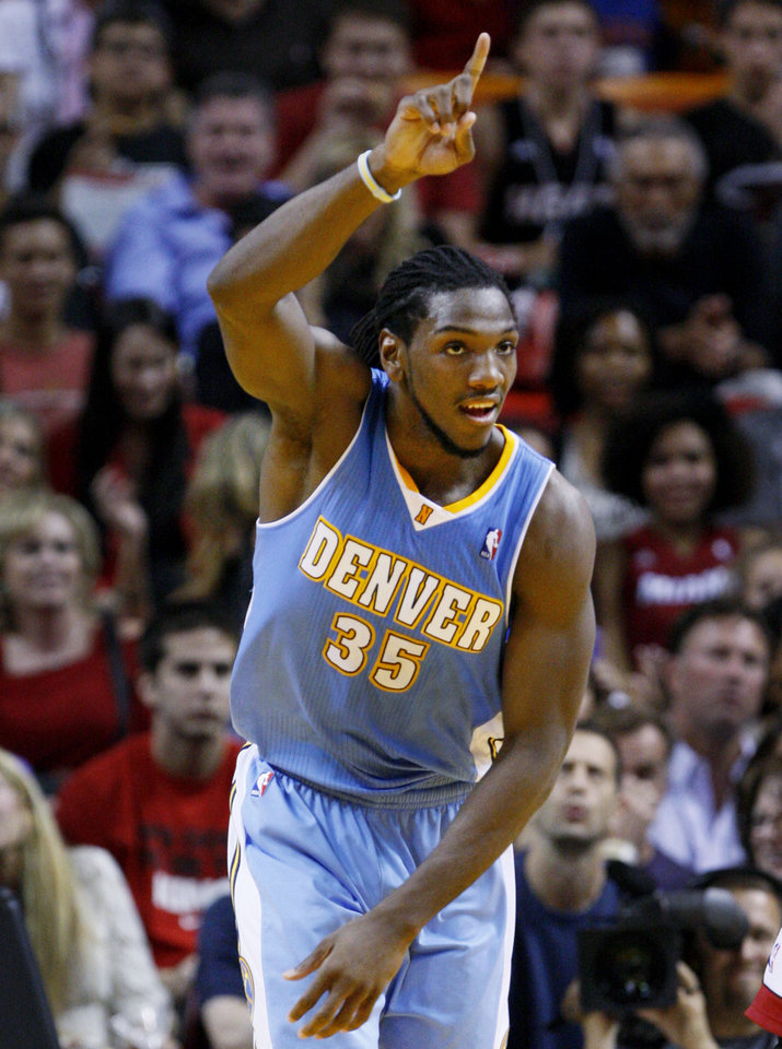 Denver Nuggets forward Kenneth Faried celebrates after dunking the ball during the first half of an NBA basketball game against the Miami Heat, Saturday, Nov. 3, 2012 in Miami. (AP Photo/Wilfredo Lee)