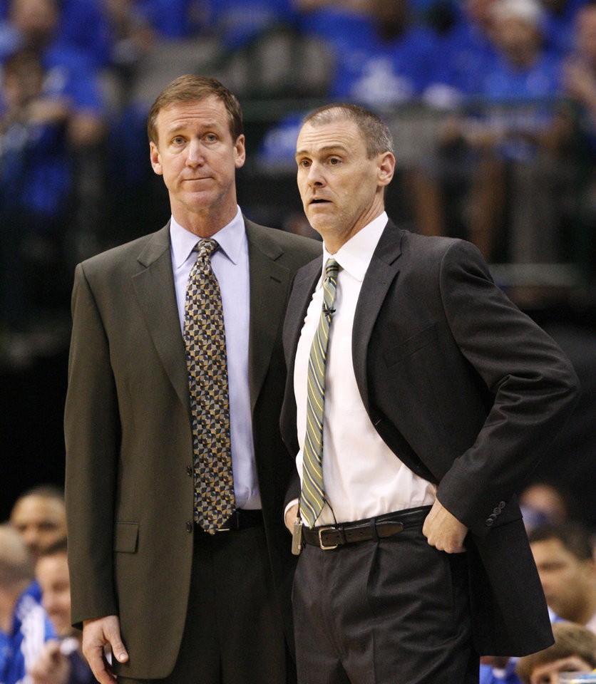 Photo -   In this May 25, 2011, photo, Dallas Mavericks assistant coach Terry Stotts, left, and coach Rick Carlisle watch Game 5 of the NBA Western Conference finals basketball series against the Oklahoma City Thunder in Dallas. The Portland Trail Blazers have hired Stotts as coach. The move announced Tuesday, Aug. 7, 2012, by Trail Blazers general manager Neil Olshey fills the NBA's last coaching vacancy. (AP Photo/Tony Gutierrez)