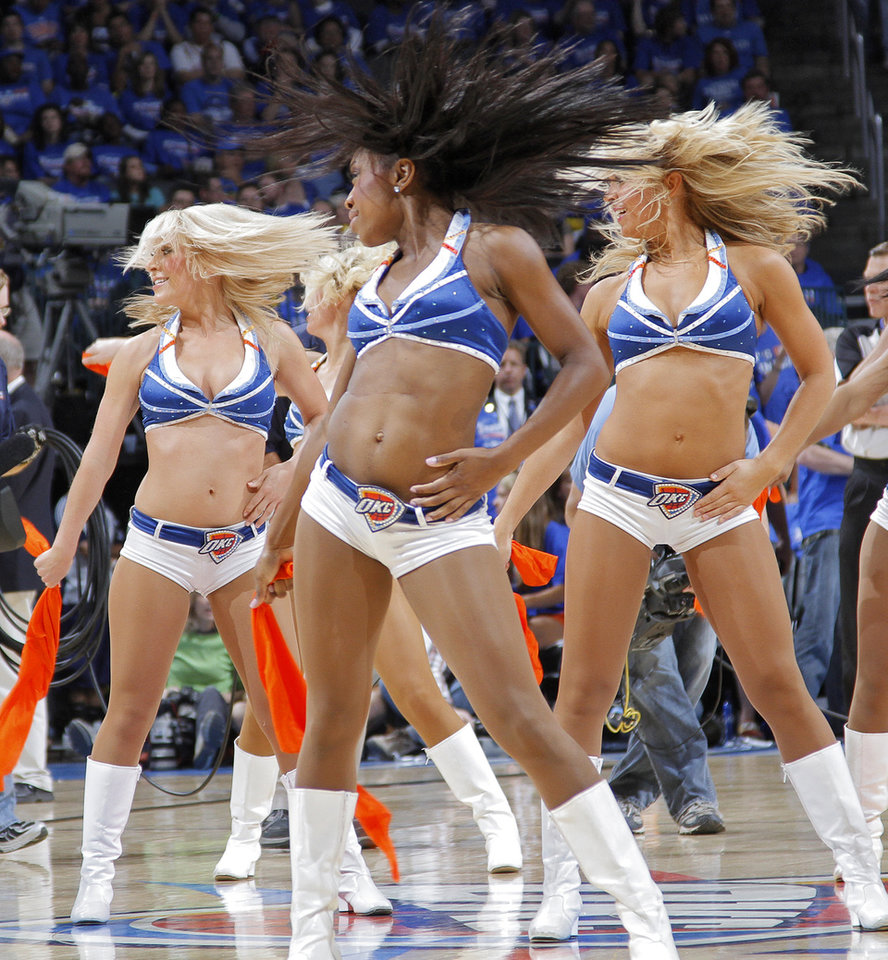Photo - Thunder girls perform during the first round NBA playoff game between the Oklahoma City Thunder and the Denver Nuggets on Sunday, April 17, 2011, in Oklahoma City, Okla. Photo by Chris Landsberger, The Oklahoman