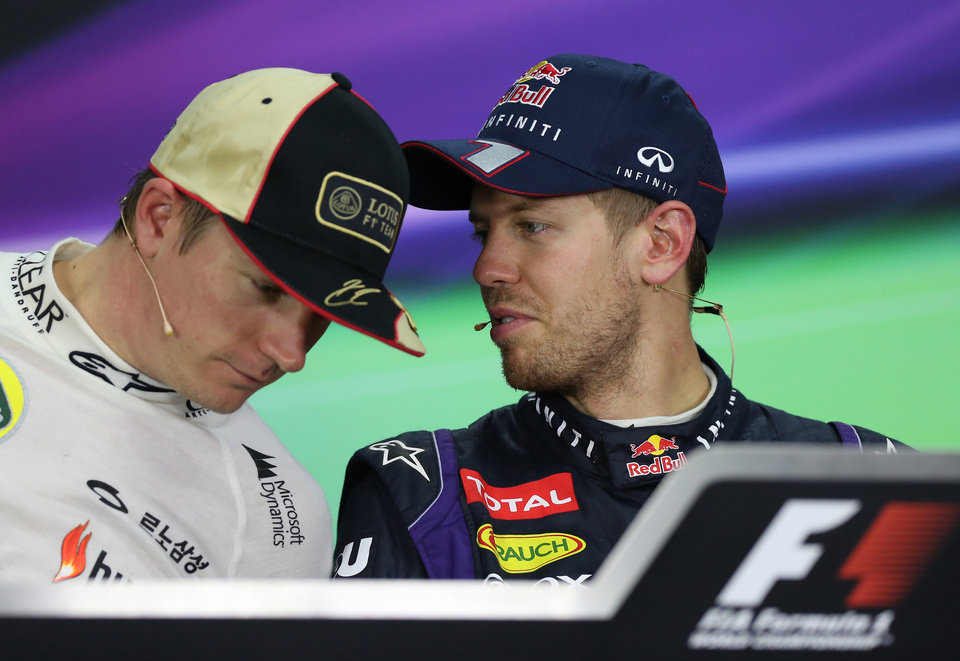 Race winner Red Bull driver Sebastian Vettel, right, of Germany talks with second placed Lotus driver Kimi Raikkonen of Finland during  a press conference following the Korean Formula One Grand Prix at the Korean International Circuit in Yeongam, South Korea, Sunday, Oct. 6, 2013. (AP Photo/Aaron Favila)