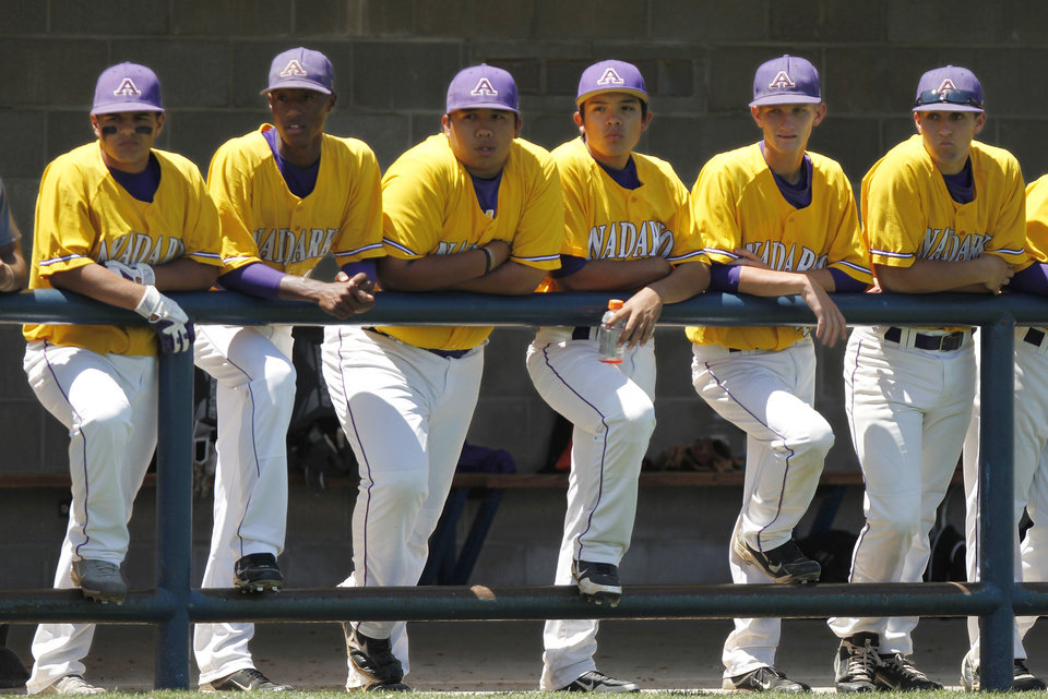 Anadarko players watch game from dugout during their 4-3 win over Tecumseh in the Class 4A state high school baseball tournament at Shawnee High School's Memorial Park. on Thursday,  May 10, 2012.     Photo by Jim Beckel, The Oklahoman