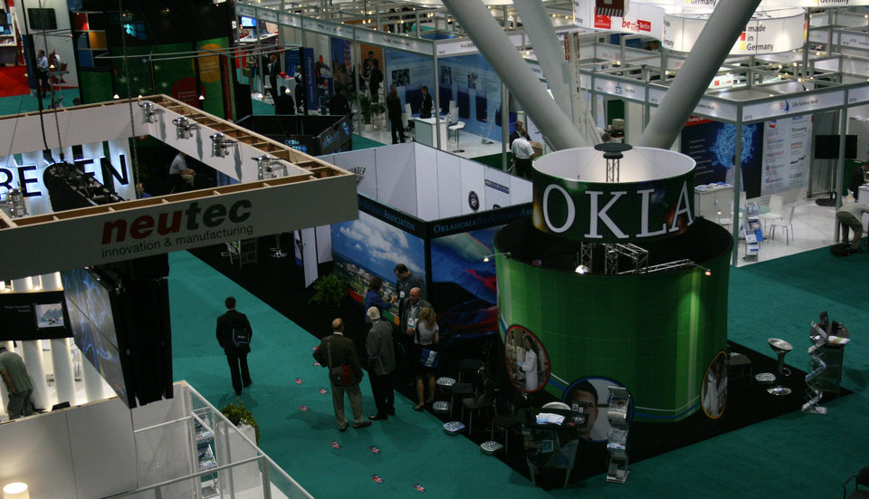 Photo - The Oklahoma BIO booth and the general display floor is shown Monday at the BIO International convention in Boston. PHOTO BY JIM STAFFORD       unknown