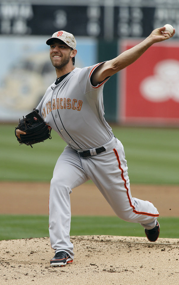Photo - San Francisco Giants starting pitcher Madison Bumgarner  throws to the Oakland Athletics during the first inning of a baseball game in Oakland, Calif., Monday, May 27, 2013. (AP Photo/Tony Avelar)