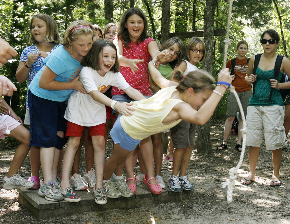 Photo - Girls use teamwork to reach goals during an obstacle course at Camp Endres, a diabetes camp held at Camp Classen in Davis, OK, Thursday, July 31, 2008. BY PAUL HELLSTERN, THE OKLAHOMAN ORG XMIT: KOD