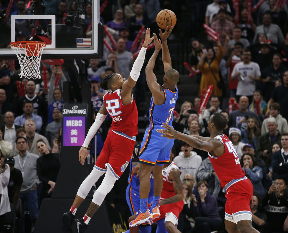 Photo - Oklahoma City Thunder guard Chris Paul (3) attempts a game-winning shot over Sacramento Kings forward Richaun Holmes (22) during the closing moments of an NBA basketball game in Sacramento, Calif., Wednesday, Dec. 11, 2019 The Kings won 94-93. (AP Photo/Rich Pedroncelli)