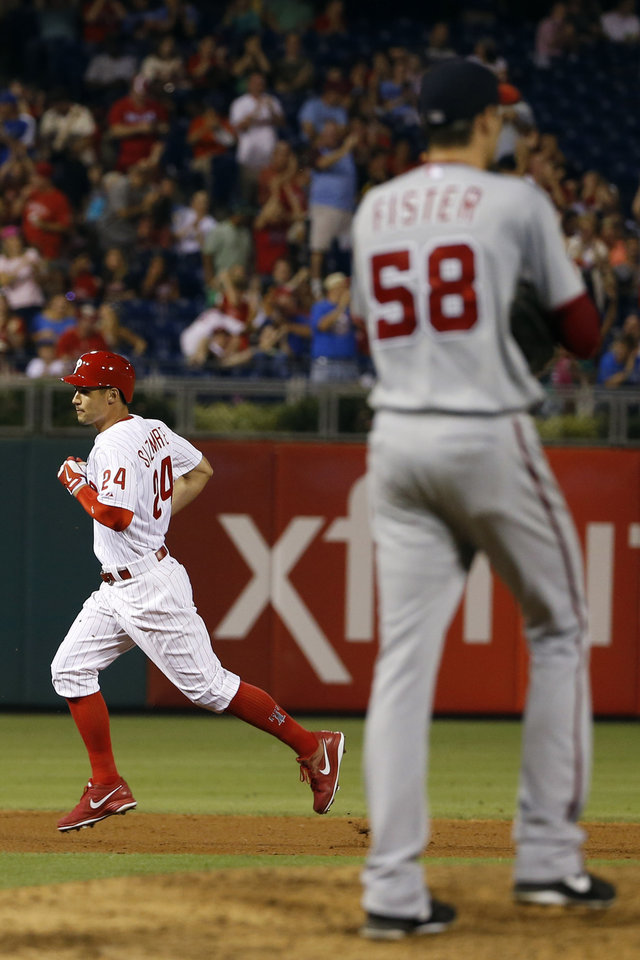 Photo - Philadelphia Phillies' Grady Sizemore, left, rounds the bases after hitting a two-run home run off Washington Nationals starting pitcher Doug Fister during the sixth inning of a baseball game, Wednesday, Aug. 27, 2014, in Philadelphia. Philadelphia won 8-4. (AP Photo/Matt Slocum)