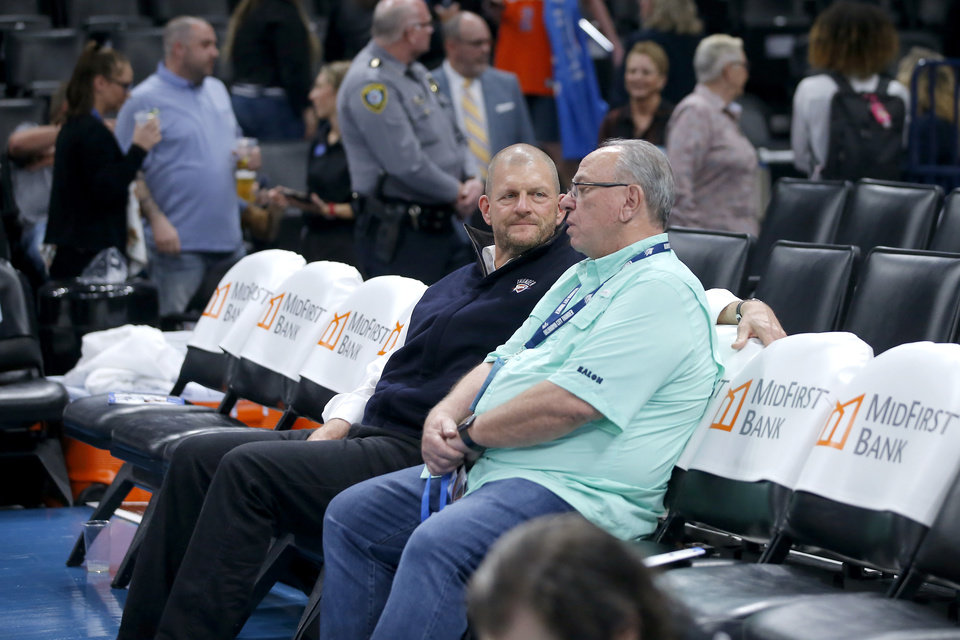 Photo - Thunder chairman Clay Bennett talks with Jay Scaramucci after an NBA basketball game between the Oklahoma City Thunder and the Utah Jazz at Chesapeake Energy Arena in Oklahoma City, Wednesday, March 11, 2020. [Bryan Terry/The Oklahoman]