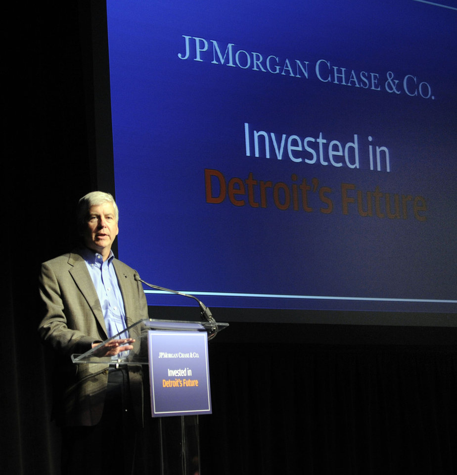 Photo - Michigan Gov. Rick Snyder speaks during an announcement about JP Morgan  Chase's investment plans for Detroit, Wednesday May 21, 2014. JP Morgan Chase's program is to commit funding to back companies pledging to invest in Detroit and provide tax-paying jobs in the city. (AP Photo/Detroit News, Chrles V. Tines)