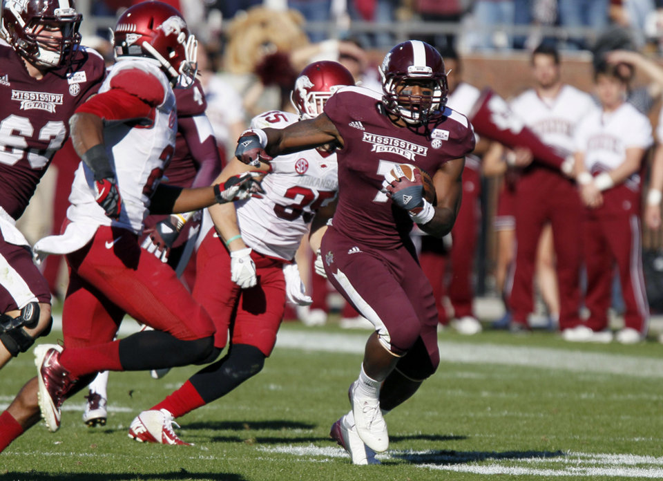 Photo -   Mississippi State running back Nick Griffin (7) runs past Arkansas defenders including safety Ross Rasner (35) for a 60-yard touchdown in the fourth quarter of their NCAA college football game in Starkville, Miss., Saturday, Nov. 17, 2012. Mississippi State won 45-14. (AP Photo/Rogelio V. Solis)