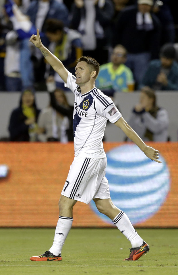 Photo -   Los Angeles Galaxy's Robbie Keane celebrates his goal against the Seattle Sounders during the first half of an MLS Western Conference finals soccer game in Carson, Calif., Sunday, Nov. 11, 2012. (AP Photo/Chris Carlson)