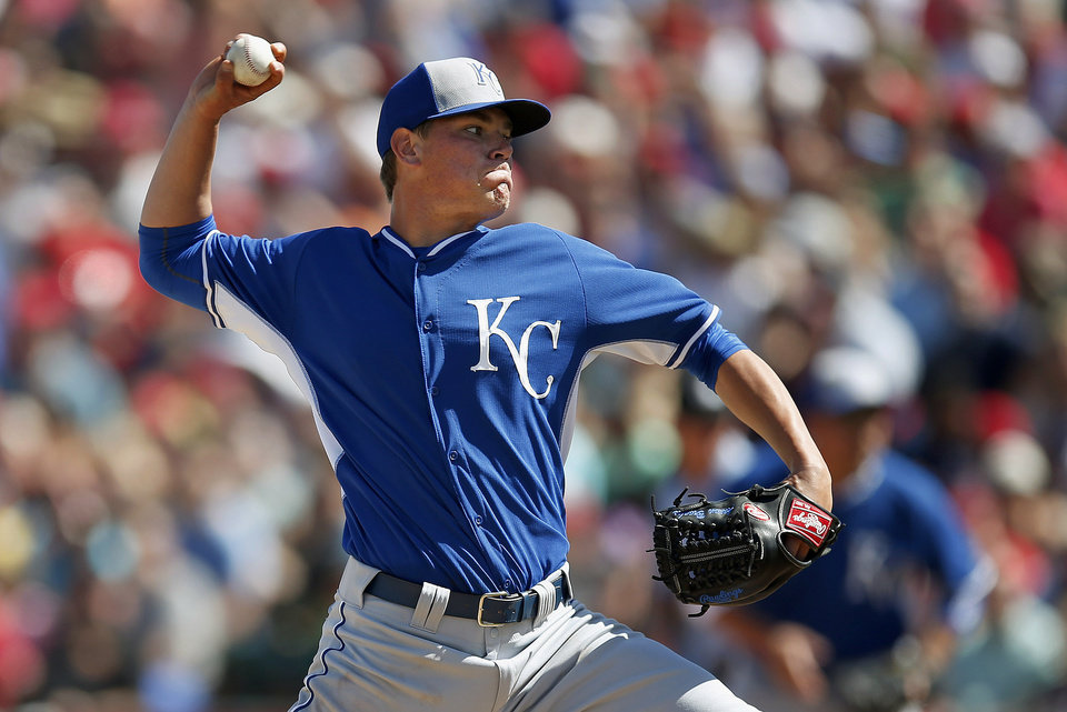 Photo - Kansas City Royals' Aaron Brooks throws a pitch against the Los Angeles Angels during the second inning of a spring training baseball game Friday, March 21, 2014, in Tempe, Ariz. (AP Photo/Ross D. Franklin)