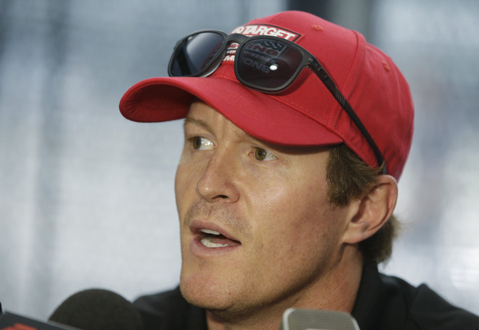 Photo - Scott Dixon, of New Zealand, responds to a question during a media interview for the Indianapolis 500 IndyCar auto race at the Indianapolis Motor Speedway in Indianapolis, Thursday, May 22, 2014. (AP Photo/Darron Cummings)