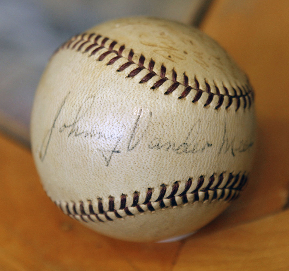 Photo - BASEBALL COLLECTION: This is one of the items in a collection of autographed baseballs on display at the Oklahoma Sports Hall of Fame in Guthrie, OK, Thursday, April 11, 2013,  By Paul Hellstern, The Oklahoman