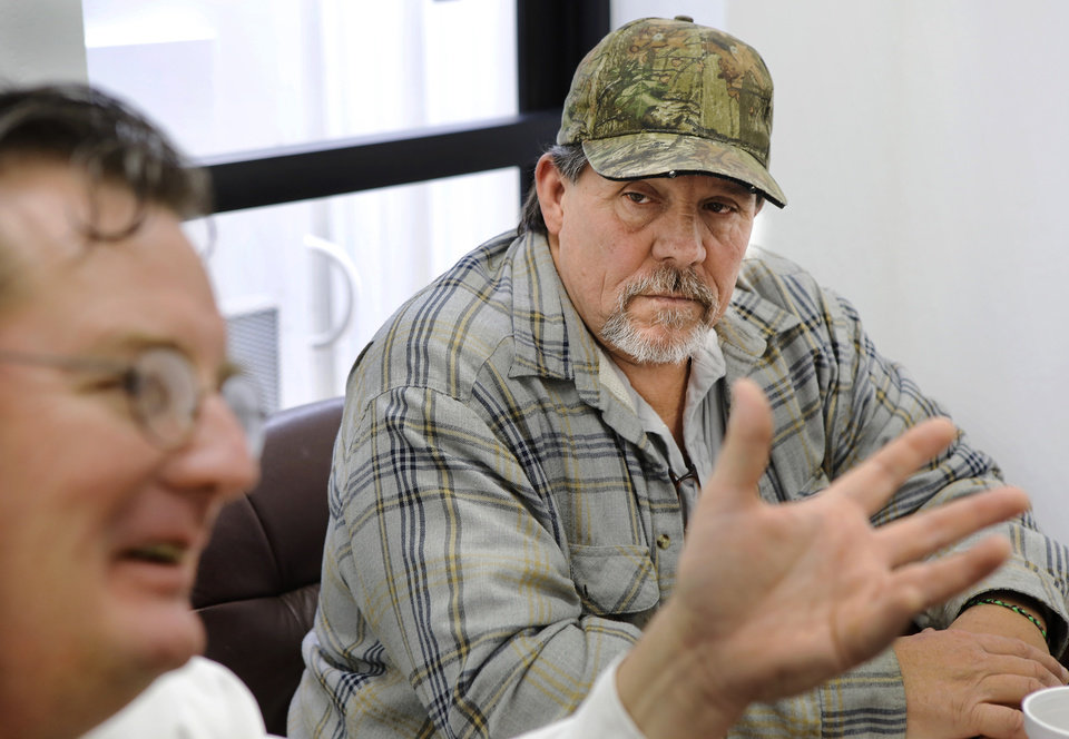 Richard McGee, right, listens to Lane School Superintendent Roland Smith discuss the merging of the Farris and the Lane school districts.  His two daughters attend Lane School, but were former students in Farris School. About 50 students transferred to Lane Public School after their former school, Farris School, was annexed by Lane in Atoka County.   Photo taken  March 1, 2013. Photo by Jim Beckel, The Oklahoman