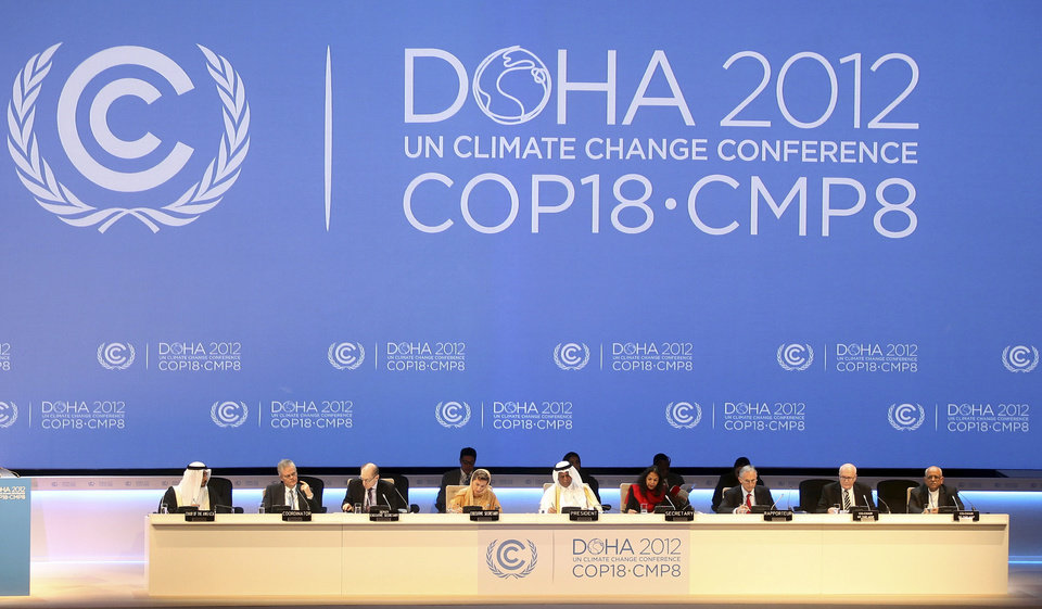 Photo - FILE - This Nov. 26, 2012 file photo shows organizers on stage at the opening ceremony of the 18th United Nations climate change conference in Doha, Qatar. The amount of heat-trapping pollution the world spewed rose again last year by 3 percent. So scientists say it's now unlikely global warming can be limited by more than a couple degrees, which is an international goal. (AP Photo/Osama Faisal, File)