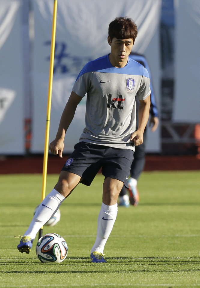 Photo - South Korea's national soccer team player Park Chu-young dribbles the ball during a training session of South Korea in Foz do Iguacu, Brazil, Thursday, June 19, 2014. South Korea play in group H of the 2014 soccer World Cup. (AP Photo/Lee Jin-man)