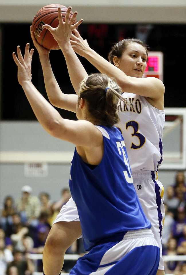 Anadarko\'s Lakota Beatty (23) looks to pass around Vinita\'s Halie Liggett (32) during a Class 4A girls high school basketball game in the first round of the state tournament at the Sawyer Center on the campus of Southern Nazarene University in Bethany, Okla., Thursday, March 7, 2013. Photo by Nate Billings, The Oklahoman
