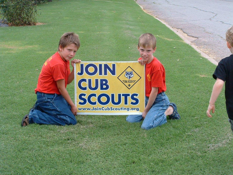 Dalton Berend and Alex White of Cub Scout Pack 117 help put out recruitment signs.<br/><b>Community Photo By:</b> Shelley White<br/><b>Submitted By:</b> Shelley, Warr Acres