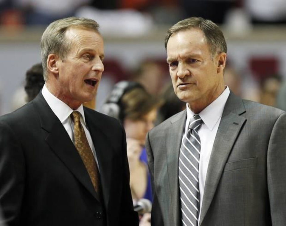 Texas head coach Rick Barnes, left, and Oklahoma head coach Lon Kruger talk before a men's college basketball game between the University of Oklahoma (OU) and the University of Texas at the Lloyd Noble Center in Norman, Okla., Monday, Jan. 21, 2013. Photo by Nate Billings, The Oklahoman