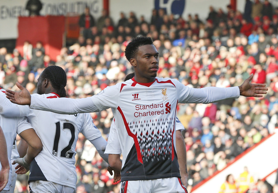 Photo - Liverpool's Daniel Sturridge celebrates his goal against AFC Bournemouth during their English FA Cup 4th round soccer match in Bournemouth, south England, Saturday, Jan. 25, 2014. Liverpool won the match 2-0.(AP Photo/Lefteris Pitarakis)
